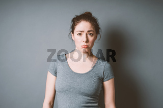 sulky pouting young woman feeling letdown and disappointment