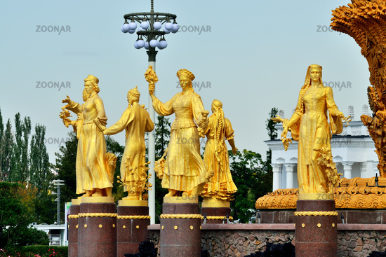 Moscow, Russia - august 12, 2019: The Peoples Friendship, Friendship of Nations, fountain with golden statues at VDNKh in Moscow