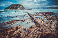 Rock formations on the seabed with Santa Clara island and San Sebastian at the background, Spain