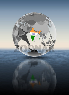 India on translucent globe above water