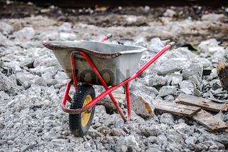 wheelbarrow on the background of construction debris