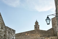 Old walls and bell tower in Dubrovnik in Croatia