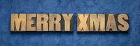 Merry Xmas greetings in wood type