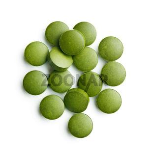 Green chlorella pills or green barley pills.