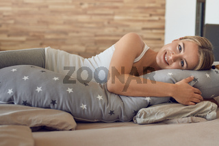 Happy healthy young pregnant woman resting