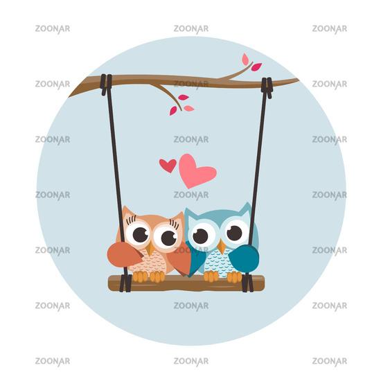 Valentine owls in love in a swing