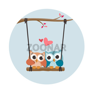 Valentine owls in love in a swing