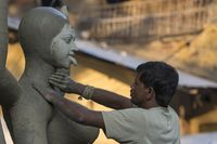 KUMARTULI, KOLKATA, INDIA, October 2014, Artisan working on completion of idol