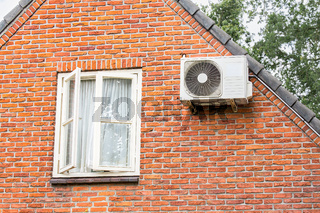 Facade of house with window and air conditioning
