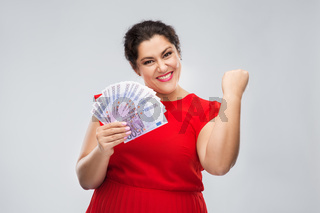 happy woman holding thousands of money banknotes
