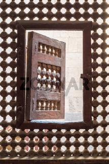 Wooden latticed window (Mashrabiya) with one small swinging sash