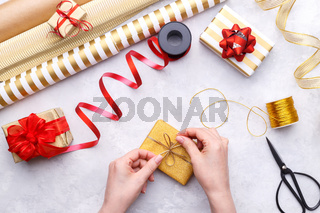 Woman's hands tying up gift box