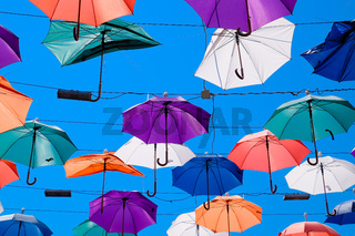 hanging umbrellas against the blue sky, walk through the streets of Kaleici, Antalya
