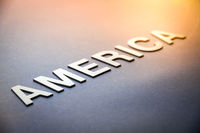 Word America written with white solid letters