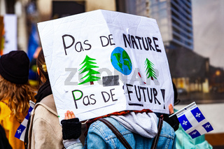 Environmentalist holds French sign