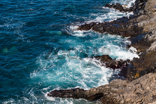 beautiful view on blue ocean water and rocky coast line