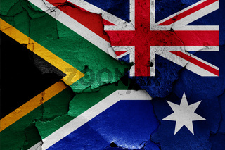 flags of South Africa and Australia painted on cracked wall