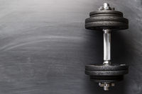Dumbbell with black weight.