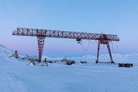 Crane in winter landscape at Pyramiden, Svalbard.