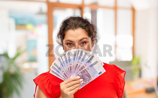 happy woman holding euro money banknotes