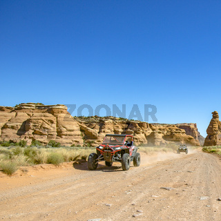 Cliffs and vehicle on an off road trail in Moab