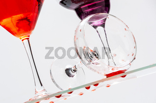 Fallen glass goblet with spilled liquid.