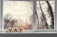VAT sign on a window sill in the morning sunrise