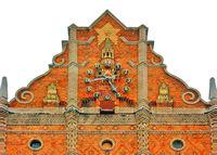 LUGANSK, UKRAINE – DECEMBER 1, 2012: The Clock on the frontal tower of The «Ukraine» Hotel.