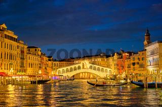 Rialto bridge Ponte di Rialto over Grand Canal at night in Venice, Italy