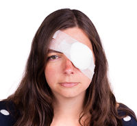 Portrait of woman wearing eye patch as protection after injury