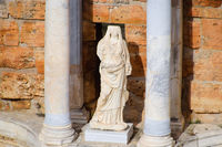 Marble statues at the columns of the amphitheater in Hierapolis, Turkey.