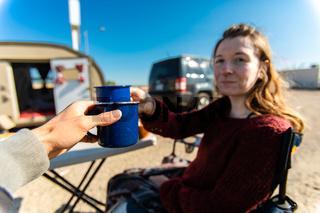 Two people drinking coffee or tea