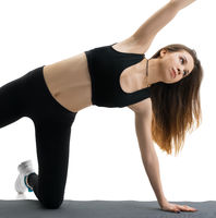 Woman doing sports exercises in studio isolated shot