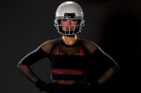 Beautiful Model Wearing A Football Helmet And Holding A Football