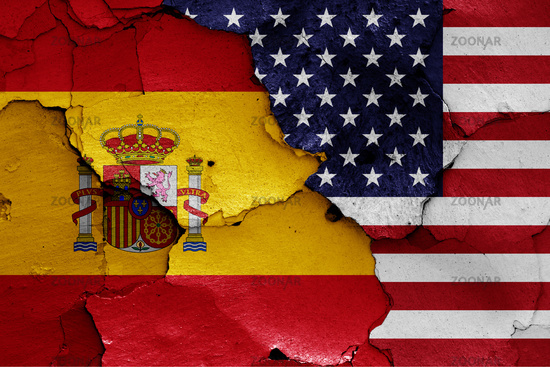 flags of Spain and USA painted on cracked wall