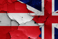 flags of Austria and UK painted on cracked wall