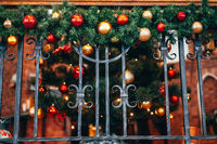Christmas decoration lies on the forged railing.