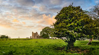 Ruins of Bective Abbey with dramatic sky at sunset. Ireland