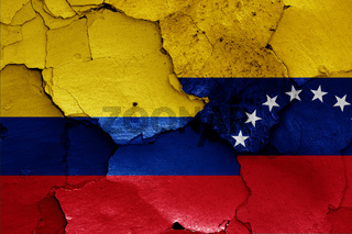 flags of Colombia and Venezuela painted on cracked wall