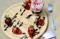 Dessert trifle with blueberry cream and strawberries.
