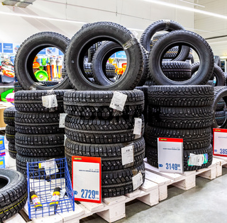 Winter vehicle tires stacked up for sale