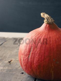 Organic Hokkaido pumpkin on wood