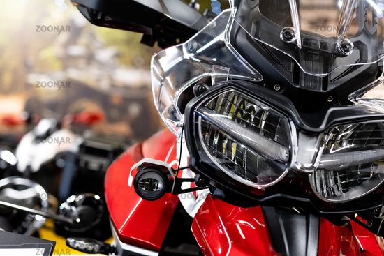 Close up of the front of a brand new enduro motorcycle, soft focus, abstract background - Image