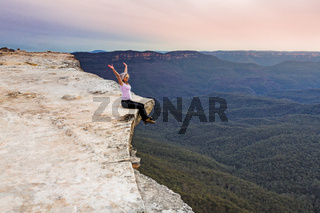Live your life to the full. Girl on cliff ledge