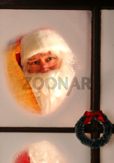 Portrait of Santa Claus seen through a frosted window as he checks his Naughty and Nice List.