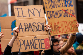 Ecological activists hold French signs