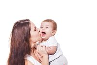 Small cute baby laughing in mother's hand