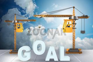 Crane lifting the word goal up