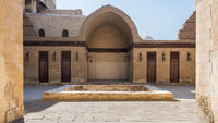 Courtyard of mosque of Sultan Al Nassir Qalawun with side arched iwan and wooden doors, Cairo, Egypt