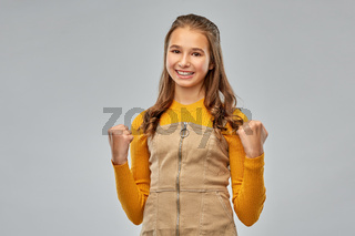 happy young teenage girl celebrating success